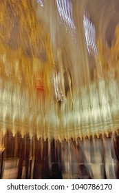 Impressionist photo at very low speed of blurred church organ, camera trepidation to give a sense of the musical instrument vibrates with the sound, ghostly figures in the cathedral,Toledo, spain,