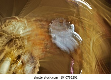 Impressionist photography in the cathedral,Toledo, with revolving camera movements, at very low speed,with trepidation to give a sensation of mysticism, mystery, abstraction, esotericism,spirituality,