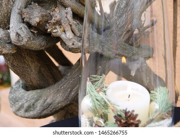 Impressions of the advent season with burning candle in the glass and rootstock,