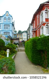 Impressions of the spa style from the small town Bansin on Usedom, Germany, at the Baltic Sea with a narrow stairway between colorful houses