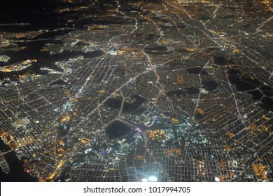 Impressive aerial view of New York suburbs seen from an airplane at night