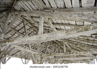 Impressive ancient, medieval roof woodwork in southwestern France . Beautiful, exclusively wooden skeleton seeing from interior.