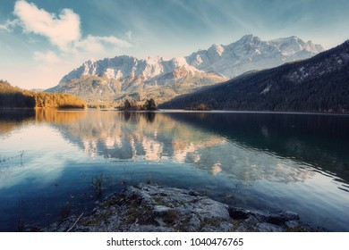 Impressive Autumn landscape The Eibsee Lake in front of the Zugspitze under sunlight. Amazing sunny day on the mountain lake. concept of an ideal resting place. Eibsee lake in Bavaria, Germany,