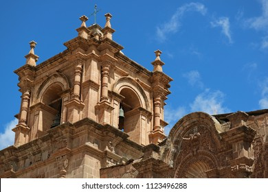 Impressive bell tower of Puno Cathedral against blue sky, Puno, Peru