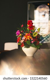 Impressive bouquet of flowers on a dining wooden table