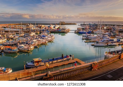 The impressive entrance to the historic Royal Harbour of Ramsgate, Kent, Uk, full of leisure and fishing boats of all sizes and a grey border force boat