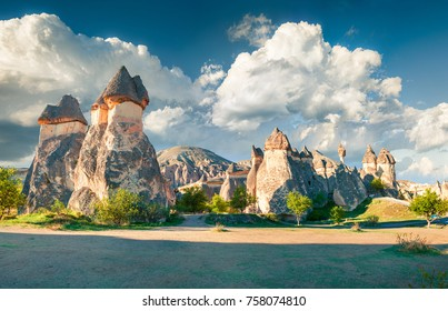 Impressive fungous forms of sandstone in the canyon near Cavusin village, Cappadocia, Nevsehir Province, Anatolia Region of Turkey, Asia. Beauty of nature concept background. Instagram filter toned.
