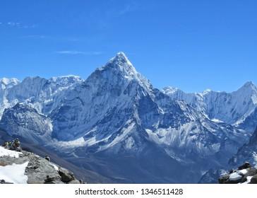 Impressive Himalayan landscape with majestic view of Ama Dablam mountain, blue sky, Sagarmatha National park, Nepal