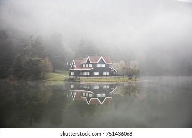 Impressive lake house in foggy weather
