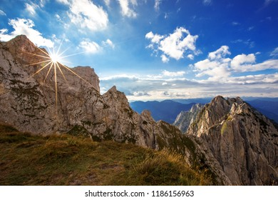 Impressive Mangart mountain in the sunset. Julian alps in Slovenia. Mountain beak in the sunset. Famous rockface for climbing. Beautiful view over South Tyrol in Italy.