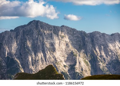 Impressive Mangart mountain in the sunset. Julian alps in Slovenia. Mountain beak in the sunset. Famous rockface for climbing. Mountain peak in the background. Rock pattern.