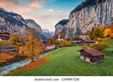 Impressive outdoor scene of Swiss Alps, Bernese Oberland in the canton of Bern, Switzerland, Europe. Magnificent autumn sunrise in Lauterbrunnen village. Beauty of countryside concept background. - Shutterstock ID 1549897100