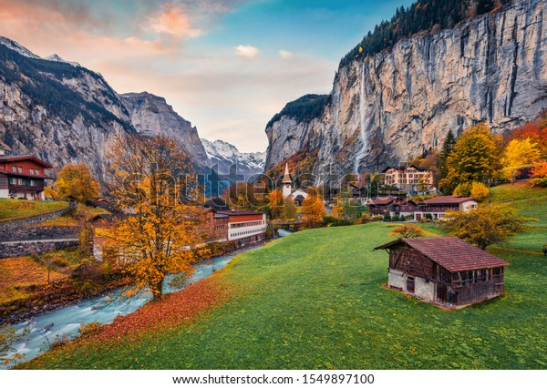 Impressive outdoor scene of Swiss Alps, Bernese Oberland in the canton of Bern, Switzerland, Europe. Magnificent autumn sunrise in Lauterbrunnen village. Beauty of countryside concept background.