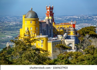 The impressive Palace da Pena over the hill with cities in the background. Sintra, Lisbon. Portugal