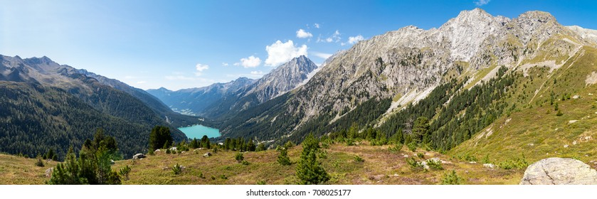 The impressive panorama seen from the Staller Sattel pass on the border of Austria and Italy, looking down on Lake Antholz with the Ohrenspitzen mountain range, part of the Riesenferner group.