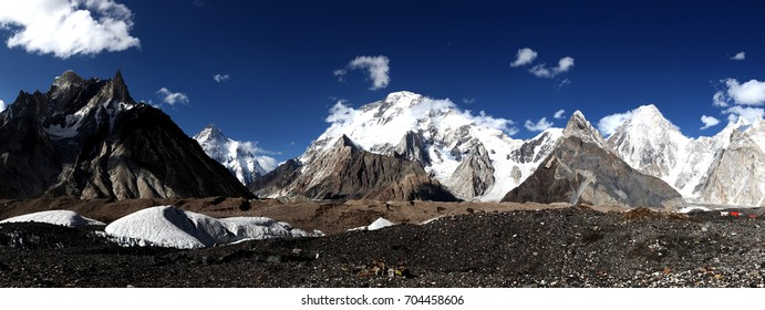 Impressive panorama view of K2,Broad Peak and Gasherbrum peak with clear blue sky at Concordia camp site in Karakorum range,Skardu,Gilgit,Pakistan.