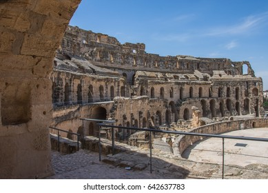 The impressive ruins of the largest colosseum in North Africa, a huge Roman amphitheater in the small village of El Jem, Tunisia. UNESCO World Heritage Site