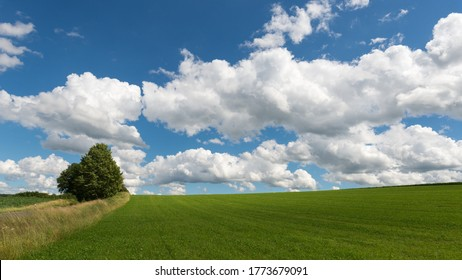 Impressive sky with cumulus clouds over a rural landscape. Germany, Hessen near Kirtorf  - Shutterstock ID 1773679091