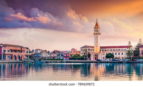 Impressive spring sunset in Zakynthos city. Dramatic evening view of the town hall and Saint Dionysios Church, Ionian Sea, Zakynthos island, Greece, Europe. Traveling concept background.