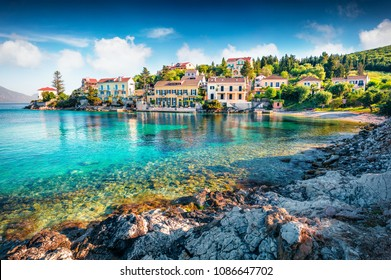 Impressive spring view of Zavalata Beach, Fiskardo village. Captivating morning seascape of Ionian Sea. Marvelous outdoor scene of Kefalonia island, Greece, Europe. Traveling concept background.