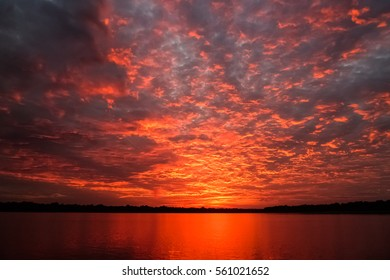 Impressive sunrise with clouds over Rio Negro, Anavilhanas Archipelago, Brazil