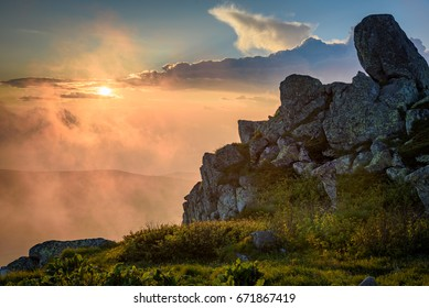 Impressive sunset on a mountain top in summer - Black Peak, Vitosha mountain, Sofia, Bulgaria