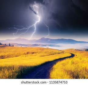 Impressive view of dark ominous sky. Moody weather. Thunderstorm with lightning. Scenic image of climate change. Location place Carpathian national park, Ukraine, Europe. Discover the beauty of earth.