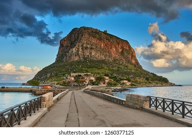 """Impressive view of the Great Rock of Monemvasia island and the medieval """"castletown"""" in Laconia against a deep blye sky. Monemvasia has also been dubbed as the Greek Gibraltar in Peloponnese, Greece"""
