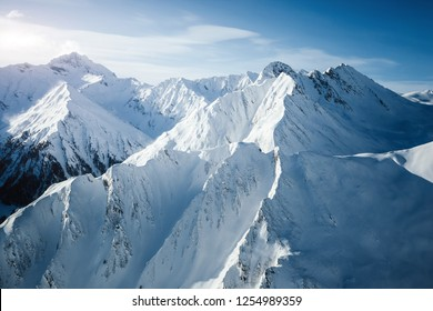 Impressive view over steep slopes on a fantastic winter day. Location place ski resort Ischgl/Samnaun on the Swiss Austrian border. State Tyrol, Europe. Great panorama. Discover the beauty of earth.