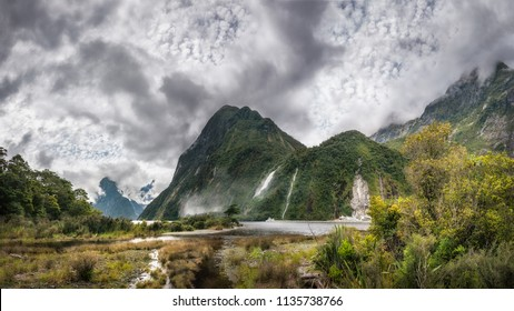 Impressive weather conditions at Milford Sound -Clouds raising and engulfing the mountain before the overnight cruise departing for Milford Sound at Fiordland National Park, New Zealand, South Island.