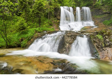 Impressive Weissbach waterfall, a tourist attraction near Inzell, Bavaria, Germany