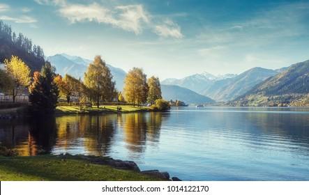 Impressively beautiful Fairy-tale mountain lake in Austrian Alps. Breathtaking Scene. Panoramic view of beautiful mountain landscape in Alps with Zeller Lake in Zell am See, Salzburger Land, Austria - Shutterstock ID 1014122170