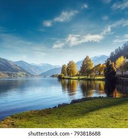 Impressively beautiful Fairy-tale mountain lake in Austrian Alps. Breathtaking Scene. Panoramic view of beautiful mountain landscape in Alps with Zeller Lake in Zell am See, Salzburger Land, Austria