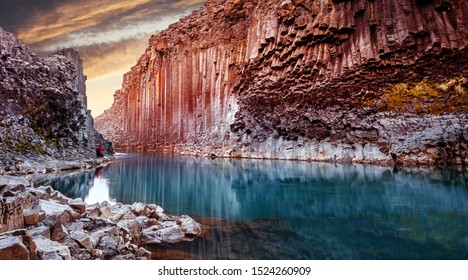 Impressively beautiful nature of Iceland. Fantastic evening landscape. Studlagil canyon of dramatic light during sunset. popular location for landscape photographers and bloggers. creative image