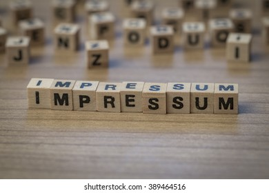 Impressum (German Imprint) written in wooden cubes on a table