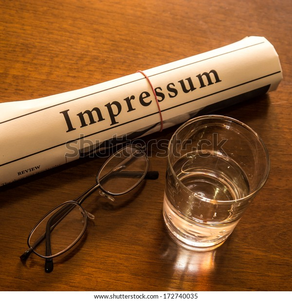 impressum, glass water, glasses on desk