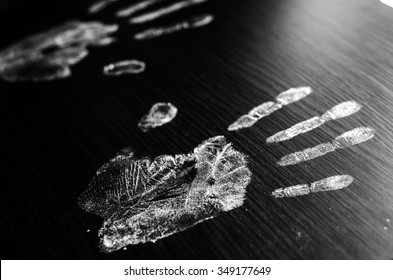 Imprint of human hands,black background