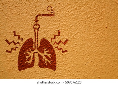 Imprint of a lung with pain signal and a lit cigarette on a grungy concrete wall for the healthcare concept: Smoking cause lung cancer.