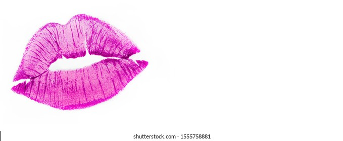 Imprint or print of pink lipstick on a white background, isolate. Make-up female lips close-up, banner. Concept of love, makeup and beauty. Sexy pink lips on white, kiss.