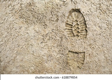 Imprint of the shoe on sand with copy space