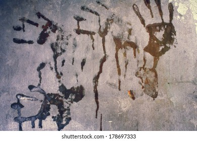 imprints of human hands on  wall