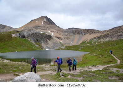 IMPROVEMENT DISTRICT NO. 9, AB / CANADA - JULY 22, 2017:  Hikers walk past Helen Lake at the end of the Helen Lake trail in the Canadian Rockies.