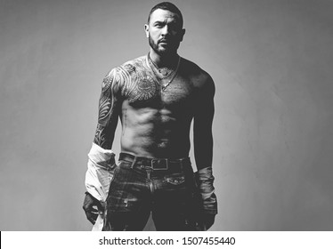 Improving his physique with testosterone. Strong hispanic man full of testosterone. Athletic latino man showing muscular body and six pack abs, testosterone concept. High testosterone level.