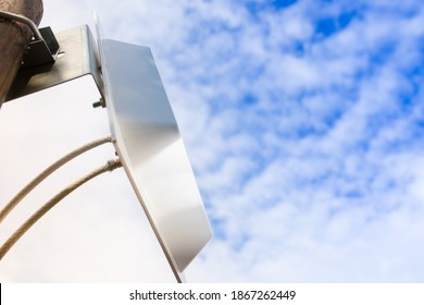 Improving poor cellular coverage with MIMO 4G antenna, on blue sky background. - Shutterstock ID 1867262449