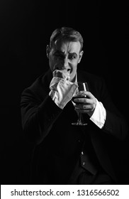 Improvisation. Mime artist perform on stage. Stage actor pantomime drinking wine. Comedian with mime makeup hold wine glass. Drama theatre actor miming. Theatrical performance art and silen comedy.