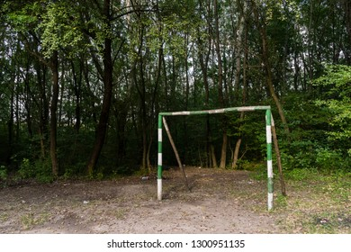 Improvised soccer goalpost on a playground for kids to play sports in a rural forest setting .