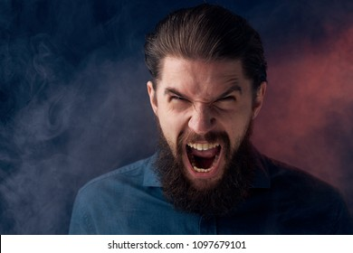 impulsive man with a beard and Smoke in the distance