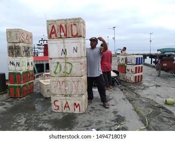 ina Marina Port,Masohi, Indonesia, 3 - September - 2019: a man reorganize box fish in the Ina Marina Port