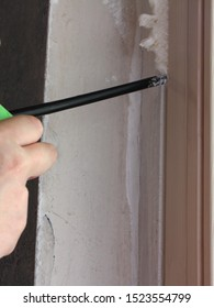 inaccurate apply a polyurethane foam from a gun on the wooden window opening