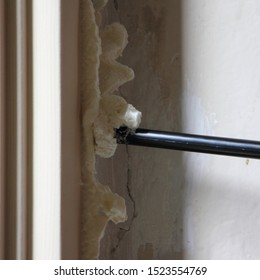 Inaccurate wrong apply a polyurethane foam from a gun on the old wooden window opening